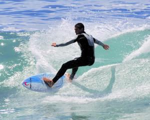 Surfer by Delfino's in Mosselbaai